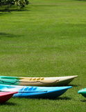 Colorful canoes on a lake bank Royalty Free Stock Photos
