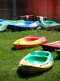 Colorful canoes on a lake bank Royalty Free Stock Image