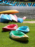 Colorful canoes on a lake bank Royalty Free Stock Images