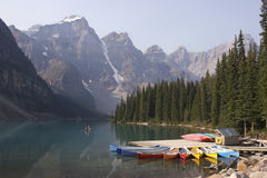 Colorful canoes and Moraine Lake, Alberta Royalty Free Stock Image