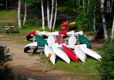 Colorful canoes and a picnic table Royalty Free Stock Images