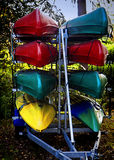 Colorful canoes on racks Stock Images