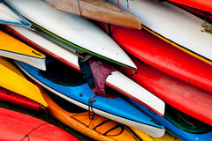 Colorful canoes stowed Royalty Free Stock Photos