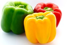 Colorful Capsicum. The close up shot of three colorful capsicum on white background royalty free stock images