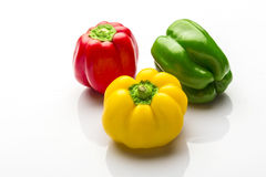 Colorful capsicum. On white background Royalty Free Stock Photos