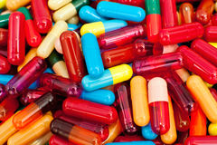 Colorful capsules Stock Images