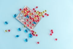 Colorful capsules and pills packed in blisters Royalty Free Stock Photo