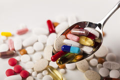 Colorful capsules and pills Stock Photos