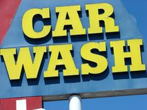 Colorful car wash sign. Yellow car wash sign with red and blue Royalty Free Stock Photo