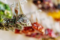 Colorful caramel sweets in transparent bags Stock Images