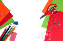 Colorful cardboard, pencils, red scissors and paper clips Stock Image