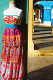 Colorful Caribbean Fashion. Colorful traditional Caribbean fashion dress on mannequin in downtown Christiansted, St. Croix, US Virgin Islands.  Displayed on the Stock Images