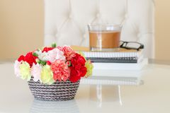 Colorful carnations in brown vase. royalty free stock photo