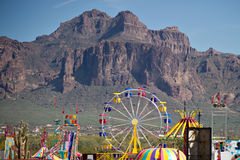Colorful carnival. A colorful carnival at the foot of the mountains royalty free stock photography