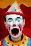 Colorful carnival clown. With it's mouth open Stock Photography