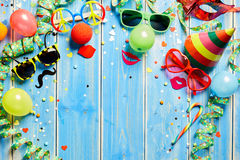 Colorful carnival frame on blue wood Stock Image