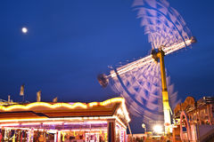 Colorful carnival fun fair at night Royalty Free Stock Photo