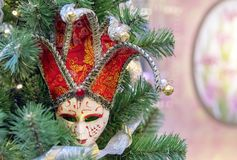 Colorful carnival mask on the background of the Christmas tree stock photos
