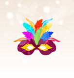 Colorful Carnival Mask with Feathers on Glowing Background. Illustration Colorful Carnival Mask with Feathers on Glowing Background, Copy Space for Your Text Stock Image