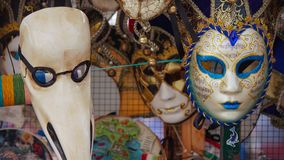 Colorful carnival masks on the market in Venice, Italy. Masks were worn in Venice to disguise the wearer from illicit activities:g. Ambling, dancing, affairs or Stock Image