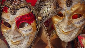 Colorful carnival masks on the market in Venice, Italy. Masks were worn in Venice to disguise the wearer from illicit activities:g. Ambling, dancing, affairs or Stock Images