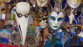 Colorful carnival masks on the market in Venice, Italy. Masks were worn in Venice to disguise the wearer from illicit activities:g. Ambling, dancing, affairs or Royalty Free Stock Photo