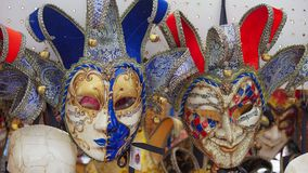 Colorful carnival masks on the market in Venice, Italy. Masks were worn in Venice to disguise the wearer from illicit activities:g. Ambling, dancing, affairs or Royalty Free Stock Image