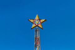 Colorful carnival ride light bulbs star shaped Royalty Free Stock Photo