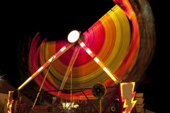 Colorful carnival ride in motion Royalty Free Stock Photo