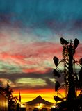 Colorful Carnival Sky. Silhouette of a carnival ride in front of a multicolored sunset Stock Photography