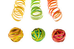 Colorful carnival strips and paper balls. Arranged colorful carnival strips and paper balls Royalty Free Stock Photos