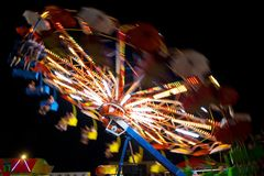 Colorful carousel. Carousel at night. Blur & spin Royalty Free Stock Photo