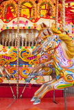 Colorful carousel. A really colourful carousel with horses royalty free stock images