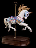 Colorful Carousel Horse. Isolated on black background Stock Photos