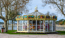 Colorful carousel in the park with wooden horses Royalty Free Stock Image