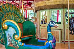 Colorful carousel ready to take children for a ride Stock Images