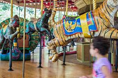 Colorful carousel ready to take children for a ride Royalty Free Stock Photos