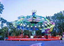 Colorful carousel spinning in the amusement park at night royalty free stock photo