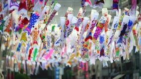 Colorful carp streamers or Koinobori in Kawagoe, Japan stock footage
