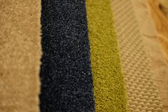 Colorful carpet samples on exhibition for retail. Close up royalty free stock images