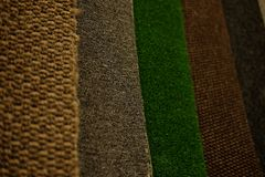 Colorful carpet samples on exhibition for retail. Close up royalty free stock photo