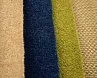 Colorful carpet samples on exhibition for retail. Close up stock images