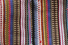 Colorful carpet in vertical stripes of different colors, traditional style for Jordan royalty free stock image