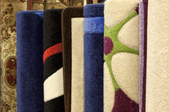 Colorful carpets in the shop Royalty Free Stock Images