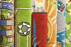 Colorful carpets in the shop Stock Image