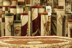Colorful carpets in the shop Stock Images