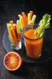 Colorful carrots and juice Stock Photos