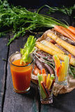 Colorful carrots and juice Royalty Free Stock Images