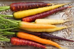 Carrots. Colorful carrots on a wooden background Royalty Free Stock Photos