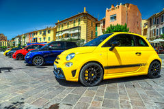 Colorful cars parked in the center of mediterranean city, France. Spectacular colorful modern cars parked in a row near Marseilles, Cassis, France, Europe Stock Image